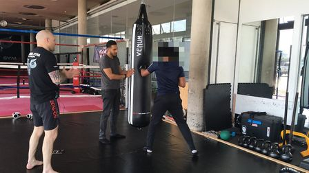 A teenager sparring with Raheel Butt and Jamie Scott at the youth sessions at Diesel Gym