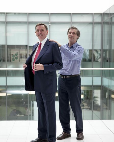 Sir Robin Wales trying on a new suit with the help of Chris Hall. Pic: Pat Coughtrey.