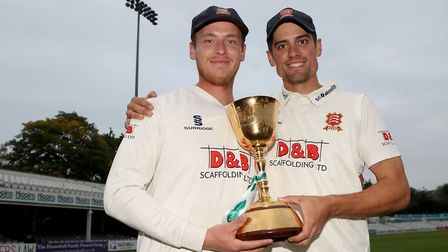 Tom Westley and Alastair Cook of Essex celebrate with the County Championship Trophy (pic Gavin Elli