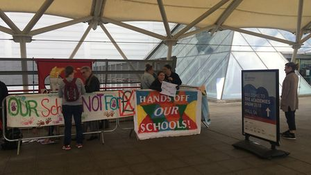 Signs and banners being hung in protest outside the Academies Show at the ExCel arena on Wednesday.