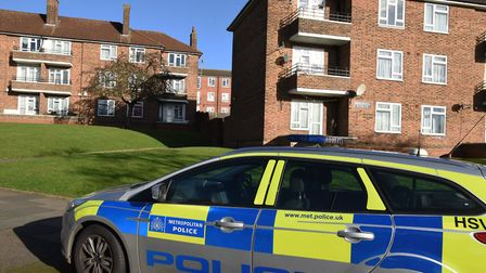 Police at the scene of where a body was found behind Brackwell House in Petersfield Avenue.