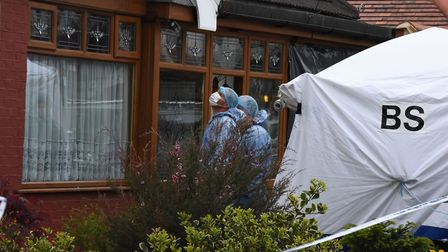 Police and forensic officers at the scene of the murder on Ashmour Gardens Romford in which an 85 ye