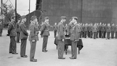 Pilot Officer Johnny Allen of 54 Squadron receives the DFC from King George VI at Hornchurch on the