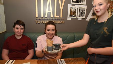 Niamh Bowdler with her brother Aaron being presented with her dessert by waitress Jessica Prior