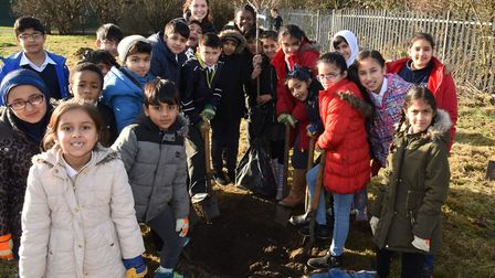 Children from South Park Primary School planting an orchard in Goodmayes Park