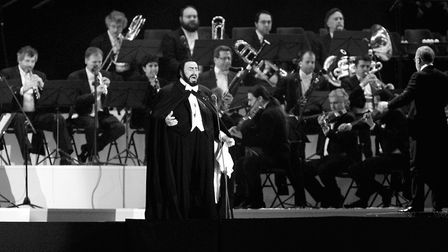 Italian singer Luciano Pavarotti performs during the opening ceremony of the 2006 Winter Olympics i
