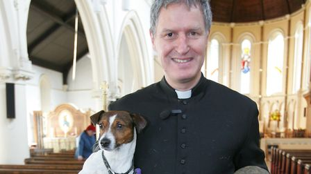 Father Robert Hampson, Jesse & Jude Anderson with Cromwell the dog & Alex the Tortoise