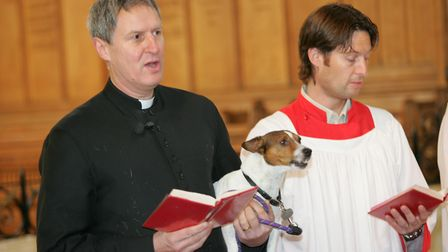 Father Robert Hampson with his dog Cromwell at a service in 2012. Photo: Steve Poston