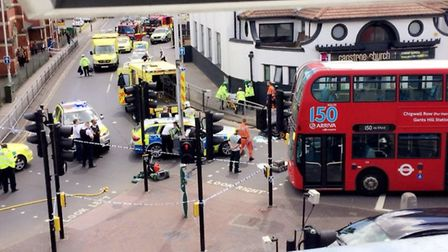 Police respond to a car crash at the junction of Green Lane and High Road, in Ilford. Photo: Samiha