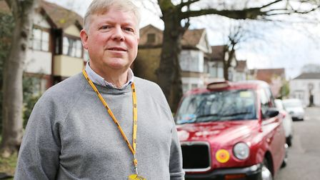 Taxi Driver and Chair of the Licensed Taxi Drivers Andy Kavanagh pictured with his cab in Ilford. Pi