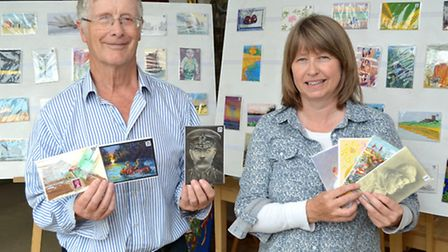 Paul and Michaela Hobbs with the postcard exhibition at the Ferini Gallery. Picture: Mick Howes