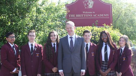 The new principal William Thompson with a group of Year 10 pupils. Picture: The Brittons Academy