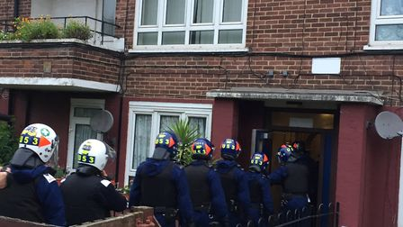 Officers entering one of the properties Picture: Met Police