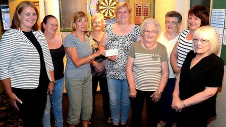 Lowestoft Lady's Charity Darts League– ChequeSarah Self handing cheque for £1250 to Helen Morris (Lo