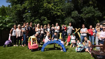 Staff and families celebrating the opening of the new play garden at the Ardleigh Green Family Centr