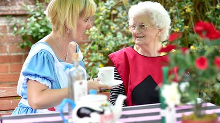 Lilac Lodge care home mad hatters tea party. Resident Kathleen Prettyman with support worker Hanna P