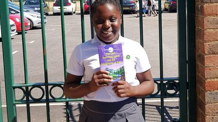 Shirley with her published fantasy book at At Albans Catholic Primary School after presenting her bo