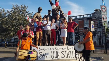 Campaigners celebrate in front of the Champions Statue. Pic: SJR Womack