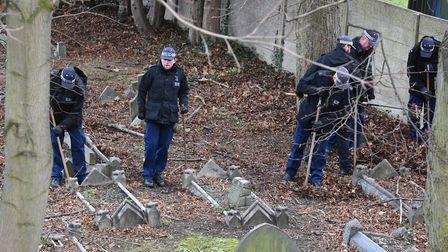Police searching the murder scene in Ilford Buckingham Road Cemetery after the discovery of the body