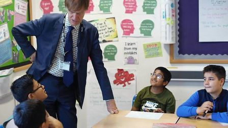 East Ham MP Stephen Timms joined children in learning about valuing money, interest rates, and the d