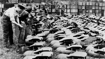 Armourers preparing the full complement of 112lb RL bombs needed for the night bombing operations by