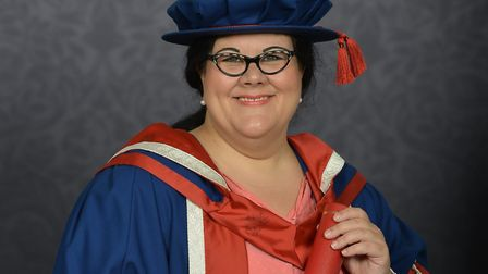 Amy Lamé in her graduation gown, holding her honorary doctorate. Picture: Ian Smithers, Tempest