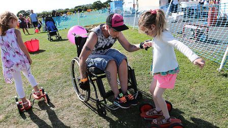 Collier Row residents Becca Nunn helping her neice Imogen Saunders, six, on the Pedal Racers at the