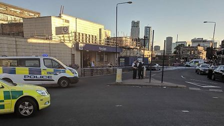 Police cordoned off an area around Maryland station. Picture: Mervyn Phillips