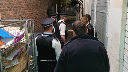 The Operation Sceptre team carry out a stop and search in a Romford alleyway. Photo: Ellena Cruse