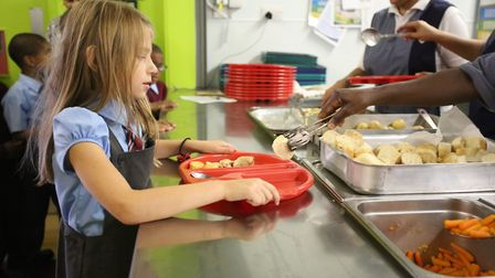 Pupils at St Aidan's Catholic Primary School in Ilford getting her free school meal.