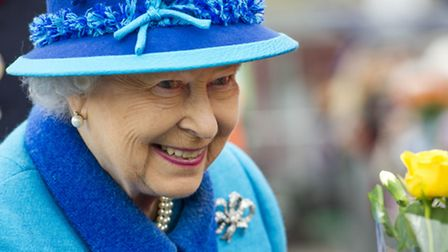 Queen Elizabeth II smiles as she opens Newtongrange railway station, on the day she becomes Britain'