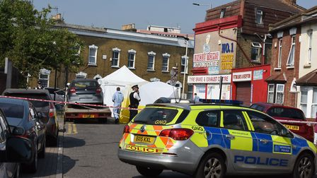 Police and a forensic team at the scene in Bective Road, Forest Gate. Picture: Ken Mears
