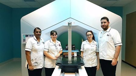 Members of the radiotherapy department at Queen's Hospital with the new Halcyon machine. Photo: BHRU