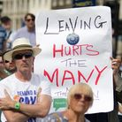 """A sign reading """"Leaving hurts the many"""" is held up during a demonstration against Brexit. Photograph"""