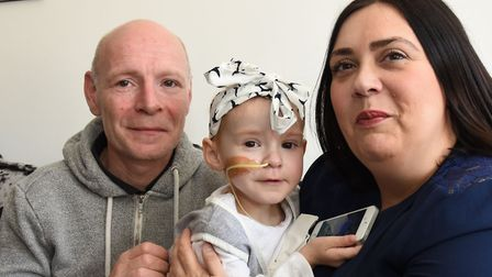 Michael Hook and Nicola Caton with their daughter Isla Caton who has been diagnosed with neuroblast