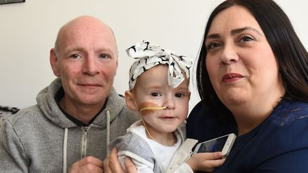 Michael Hook and Nicola Caton with their daughter, two-year-old Isla Caton who has been diagnosed wi