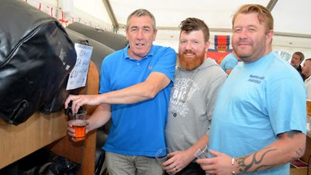Landlord Charlie Atkins and staff at the Pakefielld Beer Festival. Pictures: MICK HOWES