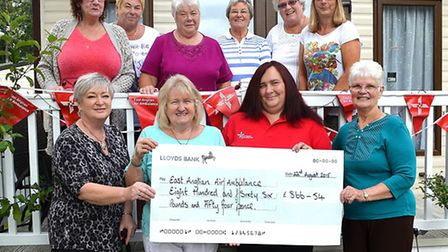 Carlton Manor Park Owners presented a cheque for £866.54 to the East Anglian Air Ambulance. Picture: