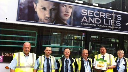 First Bus drivers in Lowestoft receive their delicious doughnuts from the Beach Radio patrol team. P