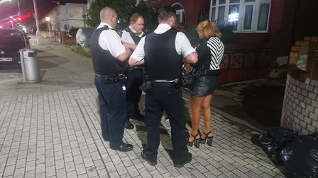 Police talking to a sex worker on Ilford Lane. Picture: Ellena Cruse