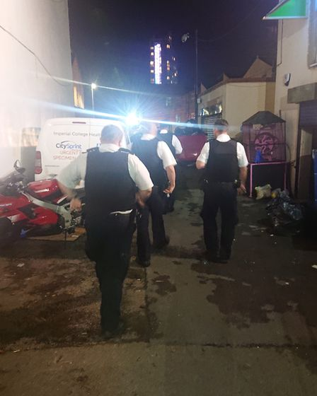 Police search the back streets of Ilford. Picture: Ellena Cruse