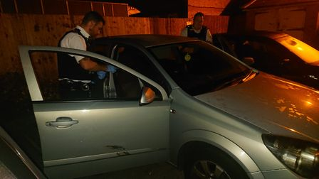 Officers search a car. Picture: Ellena Cruse