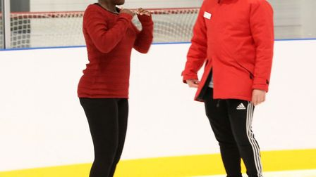 Ice skating coach Jack Newberry helping reporter April Roach with her spin at the Learn to Skate ses