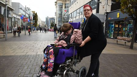 Enid Hart with her daughter Claire in Ilford High Road. She campaigned for better disabled toilet fa