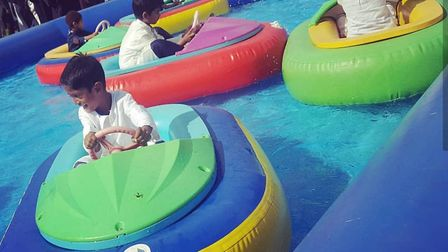Children play on water bumper cars at the Eid Fest in Goodmayes Park. Photo: Shahinasvlogs\Instagram