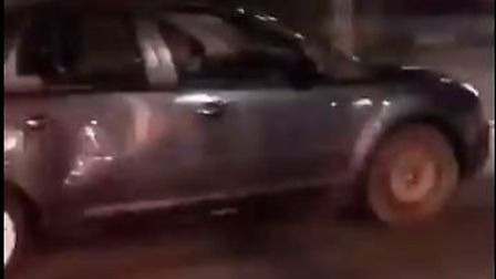 A snapchat video shows a silver car driving into a group of people. Police are investigating the cir