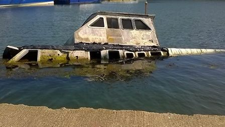 HM Coastguard Lowestoft & Southwold officers deal with reports of children playing on a sunken boat.
