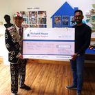 Pearly King of Forest Gate, Bob Paice, presents the cheque to Shahz Hussain. Picture: Richard House
