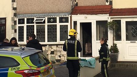 Police outside the property in Laburnum Avenue, Hornchurch, the scene of a fire. Photo: Ann-Marie Ab
