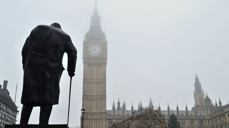 The statue of Winston Churchill in Parliament Square and the Houses of Parliament are seen in the fo
